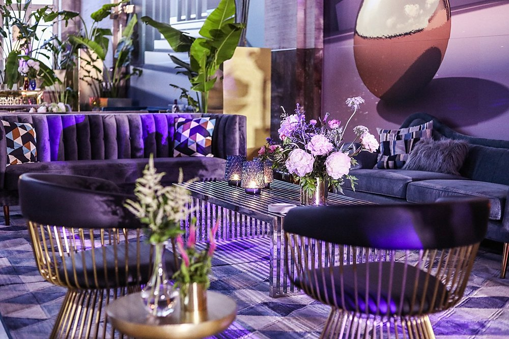 Modern and moody wedding details with velvet couches and lounge area