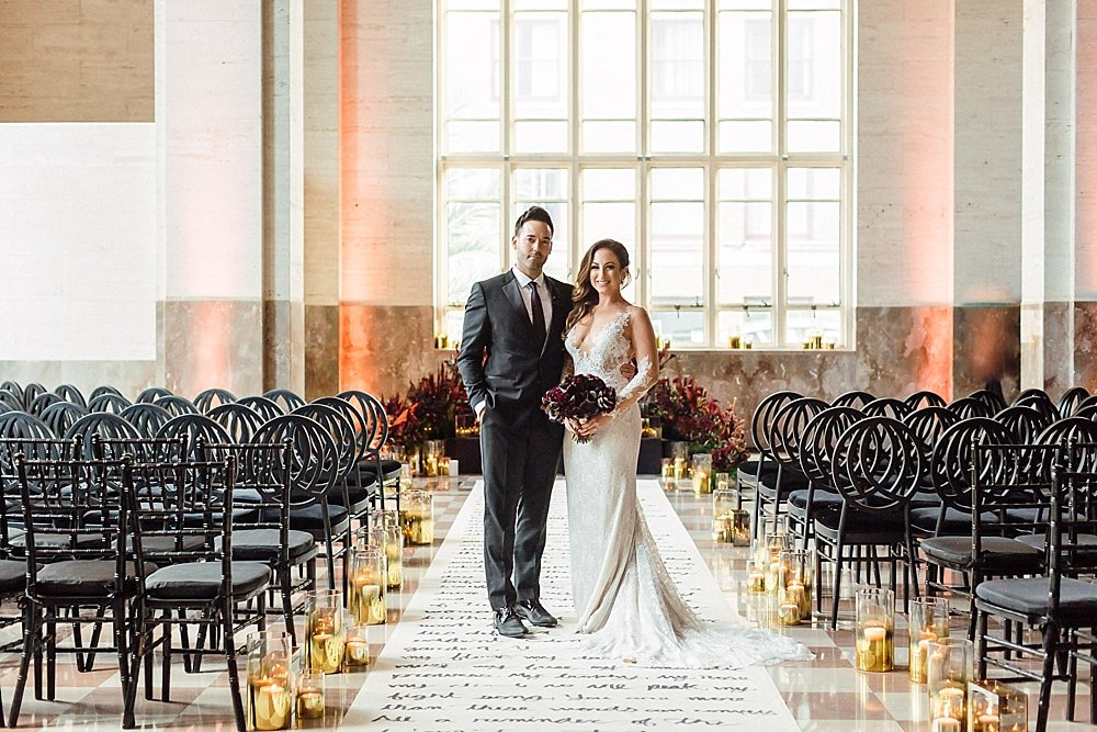 This moody and eclectic wedding at the historical DuPont Building in Miami, Florida is sure to make you swoon.